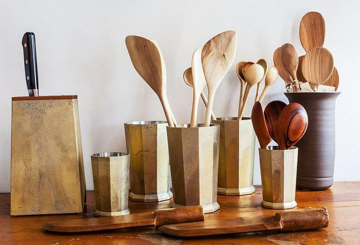 "A beautiful set of Japanese case-brass knives and wooden cooking spoons made from olive, bamboo and cherry wood rest in geometric brass utensil holders. Get more bohemian and vintage design inspiration and take a full tour on ""Inside LA's Most Charming Design Shop: Nickey Kehoe"" on the One Kings Lane Style Guide!"