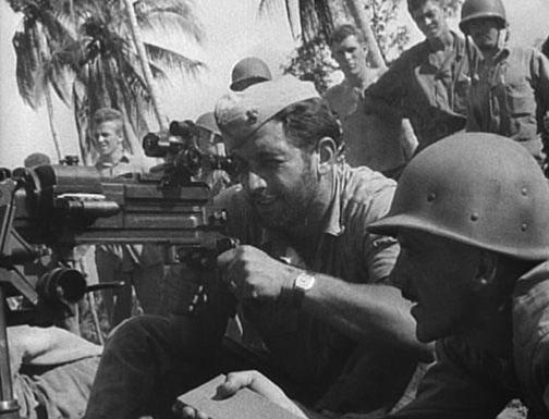 Marines test-fire a captured Japanese heavy machine gun on Guadalcanal. (Still image from USMC motion picture film)