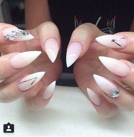 Light faded pink into clear white stiletto nail with diamonds and silver linings. Gorgeous look