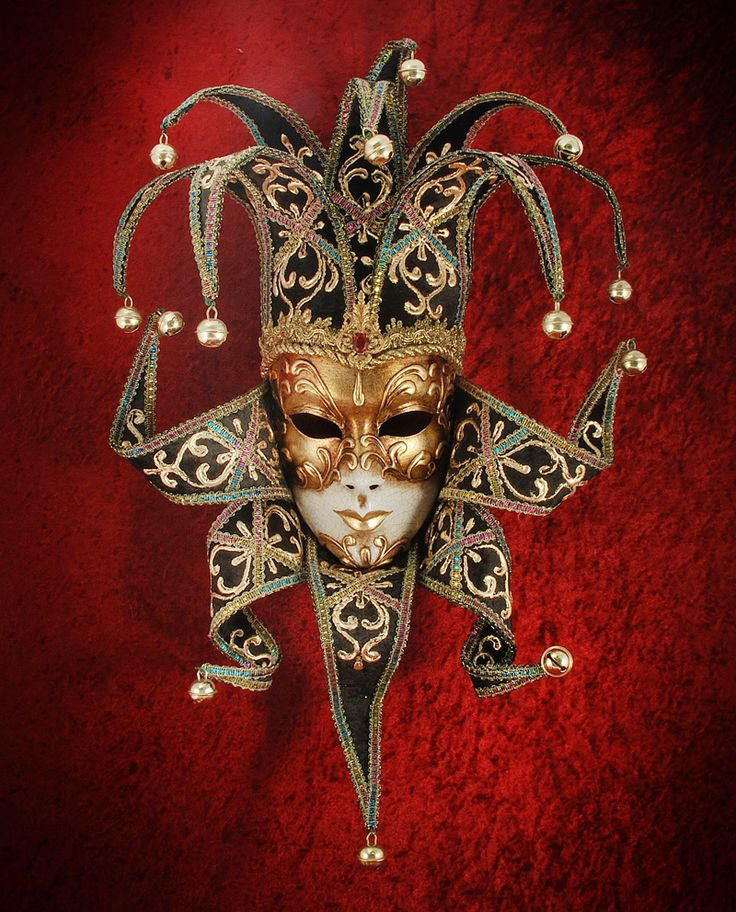 """""""Jolly Velluto Donna Black"""", €120.00    ~ Hand-decorated mask, made in Venice according to traditional artisan techniques. Decorated with stucco and gold leaf, passementerie, craquelure; fabric tines with multicoloured passementerie and bells; antiqued finish; cloth ribbon ties to fit the mask comfortably."""