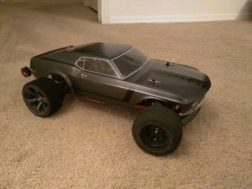 Black Widow Rustler Project - 1970 Boss 302 Mustang body on a Traxxas Rustler. Highly modified with 1/8th scale Castle setup and 90% red anodized aluminum parts. Working on an ultimate street rustler. Will update with changes.