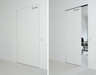A push button automatically slides door open or closed into an invisible pocket.: L'Invisibile Concealed Sliding Door