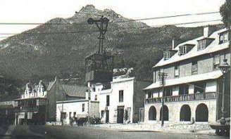 The Aerial Ropeway crossing the Main Road in Simon's Town. It operated between 1904 and 1934 and took supplies and personnel from the West Dockyard to the Royal Naval Hospital and the Sanatorium.