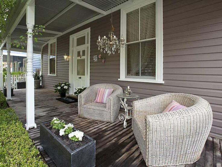 Dark taupe weatherboards & white trims