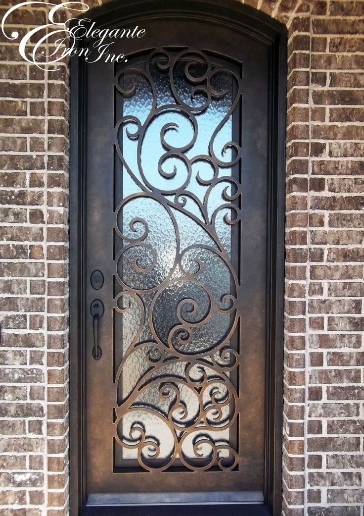 Wrought iron door with eyebrow arch.