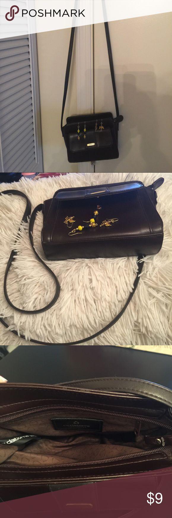Liz Claiborne mini handbag Liz Claiborne mini bag with a long trap. There little tear  on the edge overall the condition is good. Liz Claiborne Bags Mini Bags