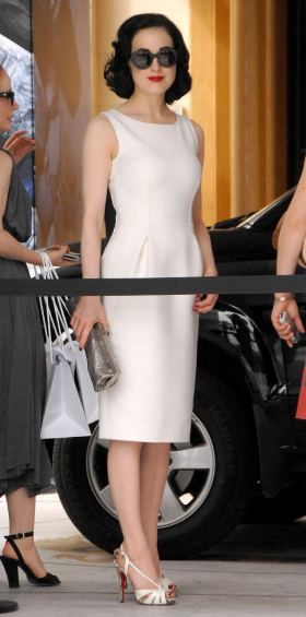 Dita Von Teese at Cannes / Snow White inspired Fashion http://www.noellesnakedtruth.com/