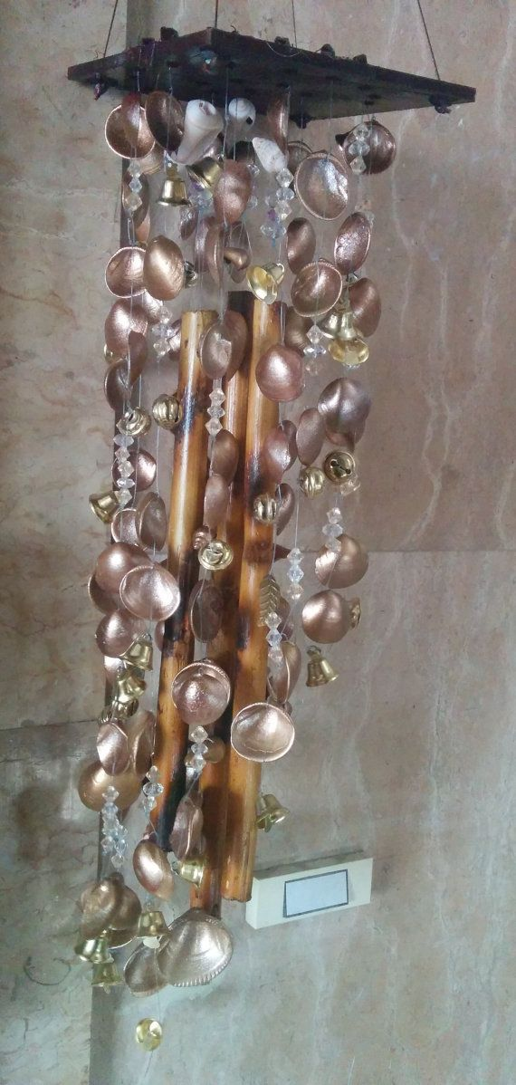 Give your porch or garden a relaxing and peaceful vibe with our hand-made Wind Chime. The seashells from the Mediterranean, the beads and natural reed, will take you on relaxing spiritual walk on the beach with every breeze. Each Wind Chime is unique and made with love by the artist
