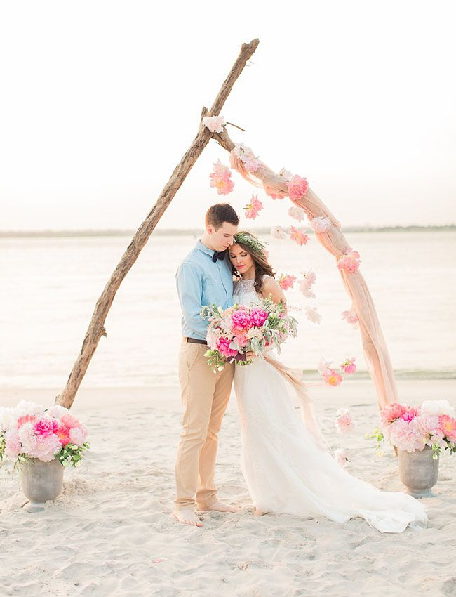 Simple yet elegant driftwood ceremony backdrop for your beach wedding.