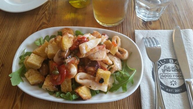 Seafood Panzanella;  Salad with Shrimp, Octopus, Calamari, red pepper, black olives, tomato, arugula, capers and house made bread