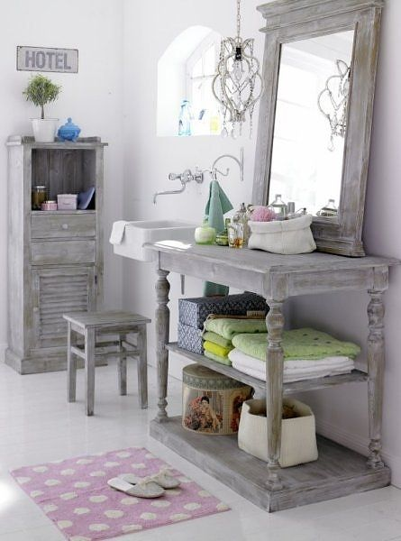 french country bathroom- love the table and mirror