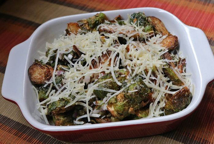 Cleveland-Heath Brussels Sprouts: tossed with capers, shallots, a lemon vinaigrette, and topped with parmesan cheese.