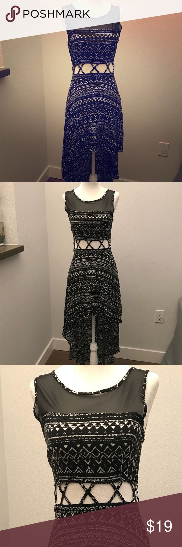 A symmetrical tank dress Stylish asymmetrical black and white tank dress with cut out X design around the stomach. Shoulder Lace design. Forever 21 Dresses Maxi