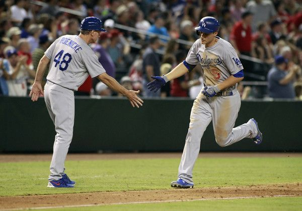 Corey Seager Photos Photos - Corey Seager #5 of the Los Angeles Dodgers (L) is congratulated by third base coach Ron Roenicke #48 following his solo home run against the Arizona Diamondbacks during the fifth inning of a MLB game at Chase Field on September 12, 2015 in Phoenix, Arizona. The Dodgers defeated the Diamondbacks 9-5. - Los Angeles Dodgers v Arizona Diamondbacks