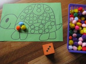 A simple game - roll the dice, then add that many pieces to the pattern. Kids can work cooperatively or race to fill their patterns. Use pompoms, buttons, or BINGO chips as tokens.