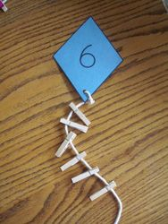 """Simple idea - attaching correct number of mini-pegs to the knife string ("""",)"""