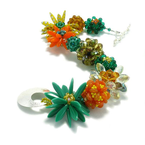 Clear and true yellow, energetic teal, and rich yellow, orange interplay the length of the bracelet to create a delightful tribute to a colorful garden. Czech glass beads, Chinese crystals, and an oversized Kathryn Bowman Studio handmade toggle brings everything together. It's a party for your wrist. Put it on Your wrist! $198.00 #jewelry #handmade jewelry #flower jewelry #fashion