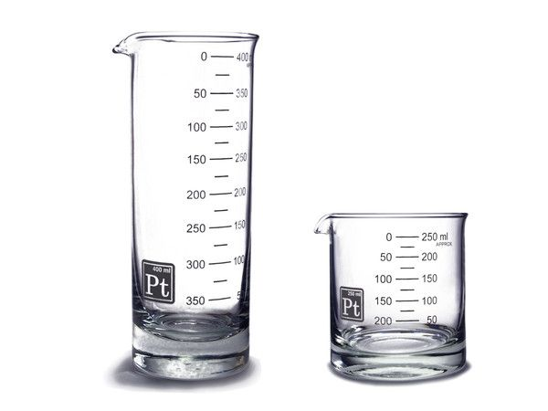 laboratory scientific glass rocks and highball  drinking glasses solid glass beakers water