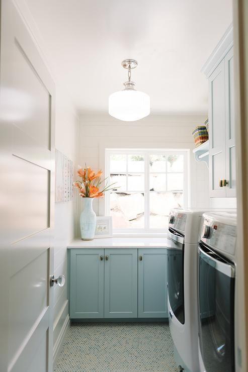 Blue Laundry Room Features A Schoolhouse Pendant