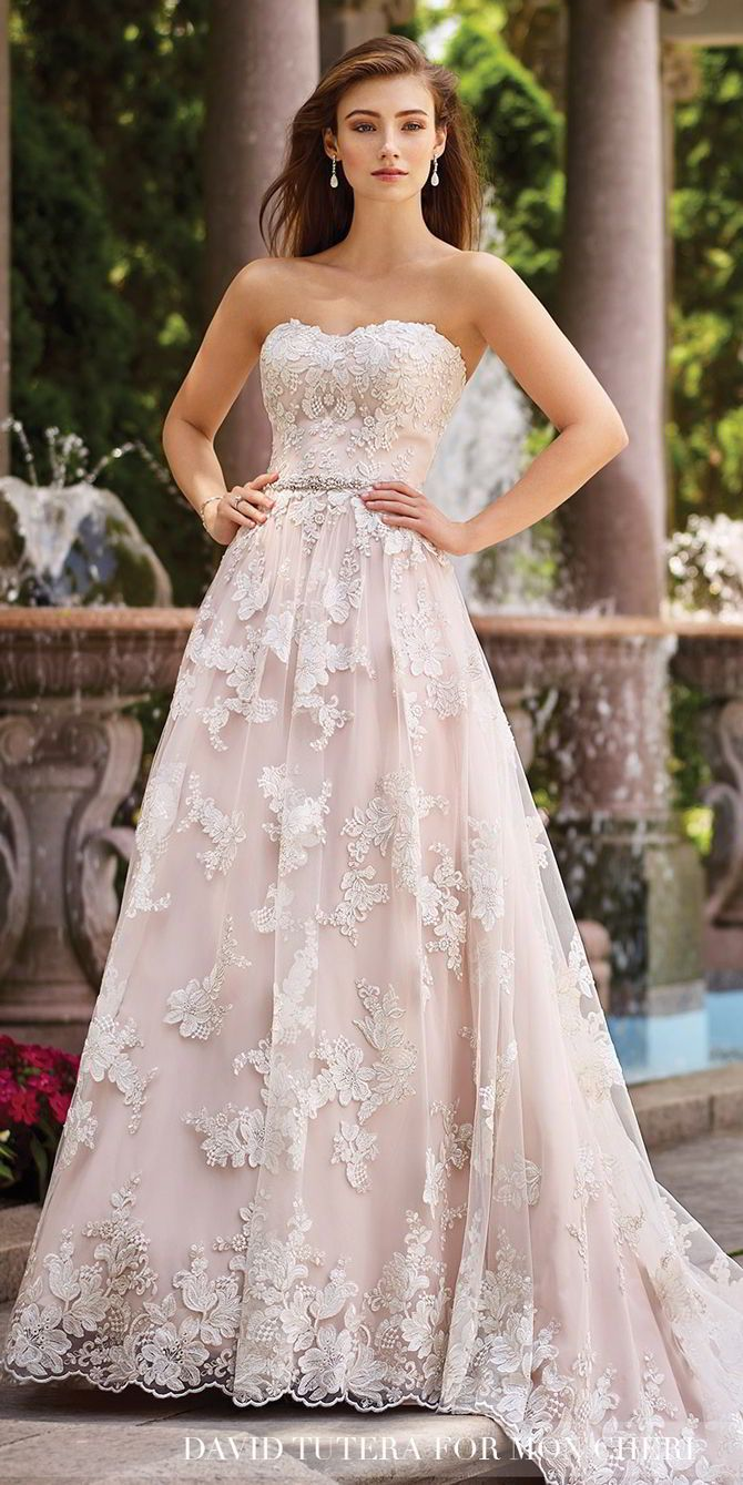 Strapless re-embroidered Schiffli lace on tulle over chiffon slim A-line gown with scalloped soft sweetheart neckline, hand-beaded natural waist, scalloped hemline, chapel length train, detachable spaghetti and halter straps included.