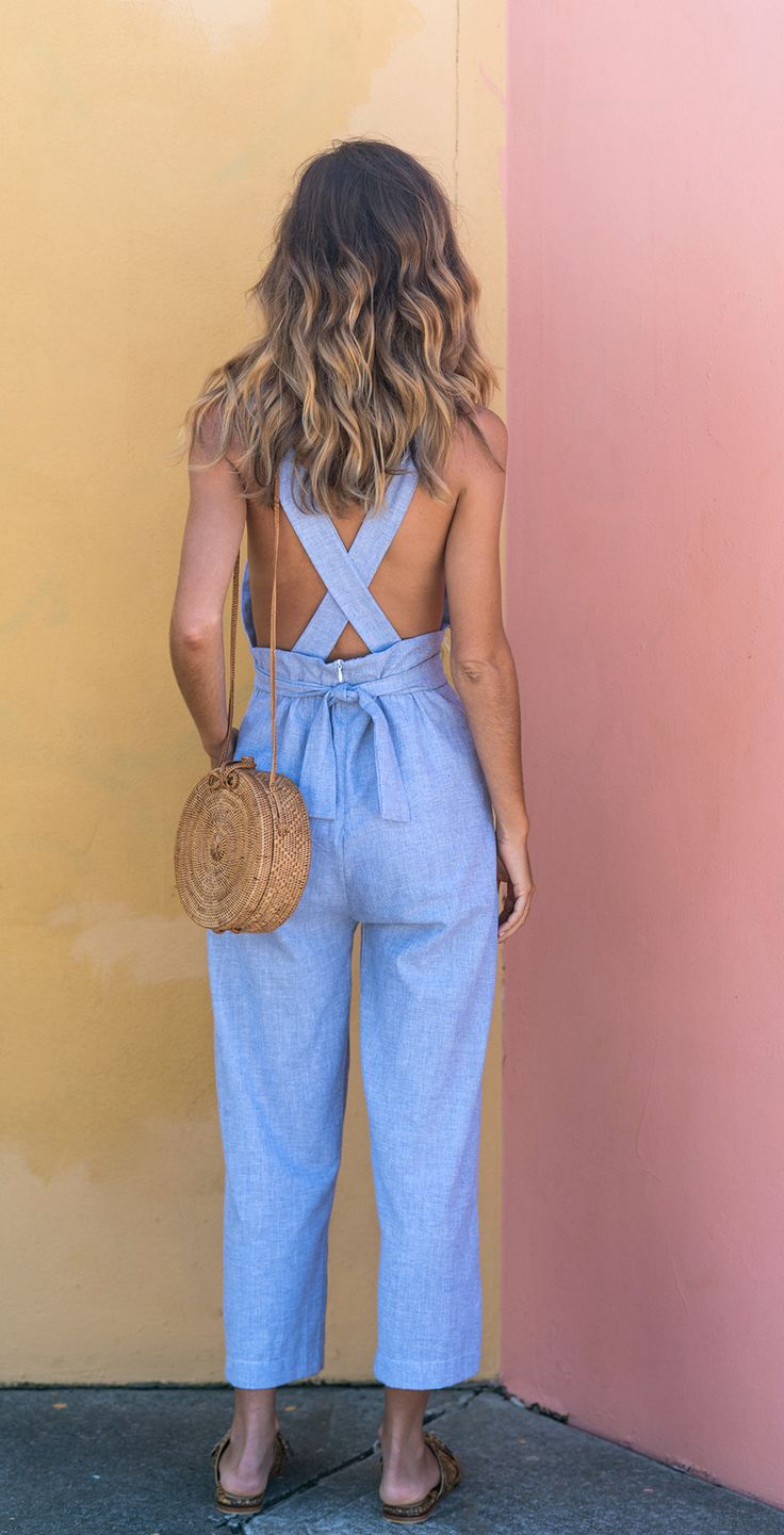 * Cross back feature * Adjustable buttoned straps * Waist tie front detail * Invisible back zip entry * Crop length 100% Linen- Chambray Model wears size XS.