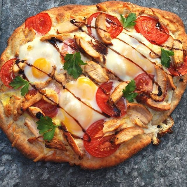 Made this pizza with leftovers from last night! A bit of mozzarella, parmesan, chicken and tomato, topped with eggs and a drizzle of balsamic vinegar! 👌🏼 Stone cooked to perfection