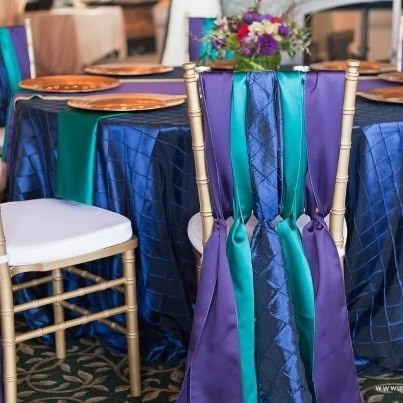 Loving this fun and colorful jewel toned table setting. The mix of texture with the Midnight Blue Pintuck and Purple and Teal Lamours make for a beautiful combination.   Photo: Matt and Jentry