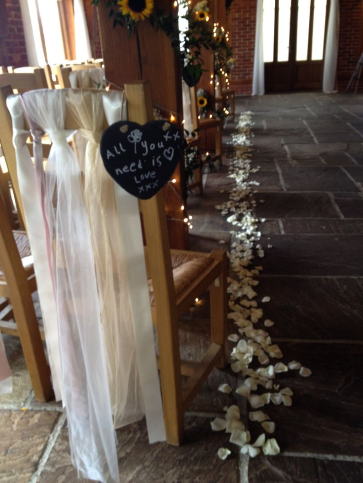 Slates, Petals, Ribbons and Sunflowers in The Oak Barn at The Ferry House Inn, Kent. www.theferryhouseinn.co.uk