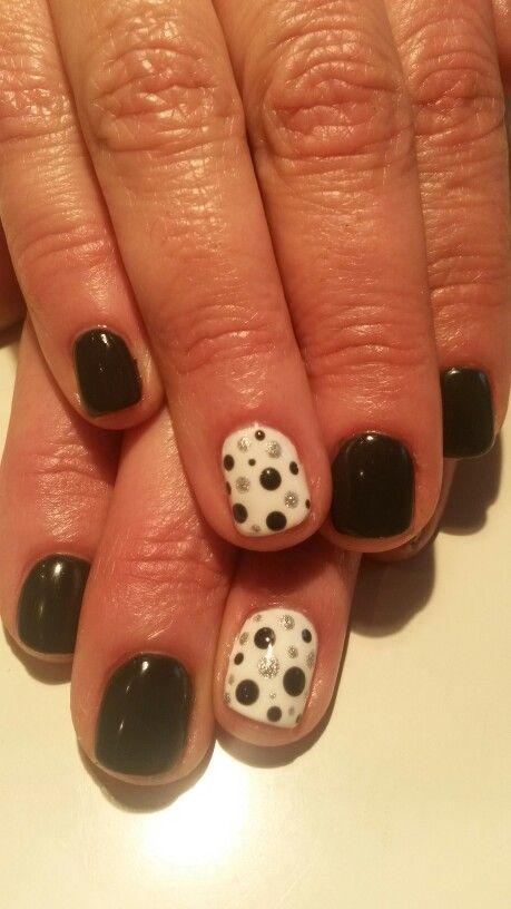 Grey with polka dots nail design