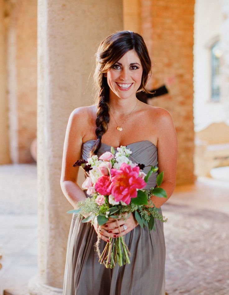 bridesmaid in a lovely gray gown carries her loosely tied bouquet of hot pink dahlia, light pink lisianthus, white stock, hot pink garden rose, cream vendela rose, light pink spray rose and chocolate cosmos.