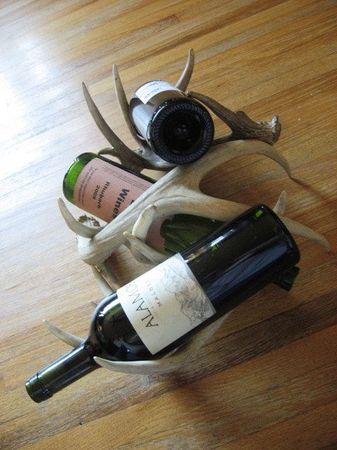 Three Piece Deer Antler Wine Rack by Deer & Dear on Etsy, $89.99 Unique custom made deer antler wine rack, created with naturally shed deer antlers found in central South Dakota. This hand-crafted centerpiece would add a rustic, prairie feel to your home's decor. You will never find another one like this, as each horn is as original as the buck that dropped it. #SouthDakota