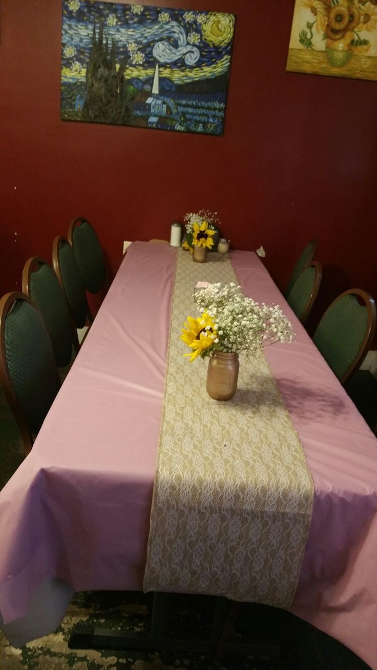 Had the shower at a restaurant.  We covered all the tables with pink table clothes and used lace burlap table runners with gold mason jars filled with sunflowers and baby's breath as the center pieces
