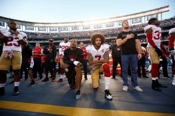 Colin Kaepernick and Eric Reid - Michael Zagaris/San Francisco 49ers/Getty Images
