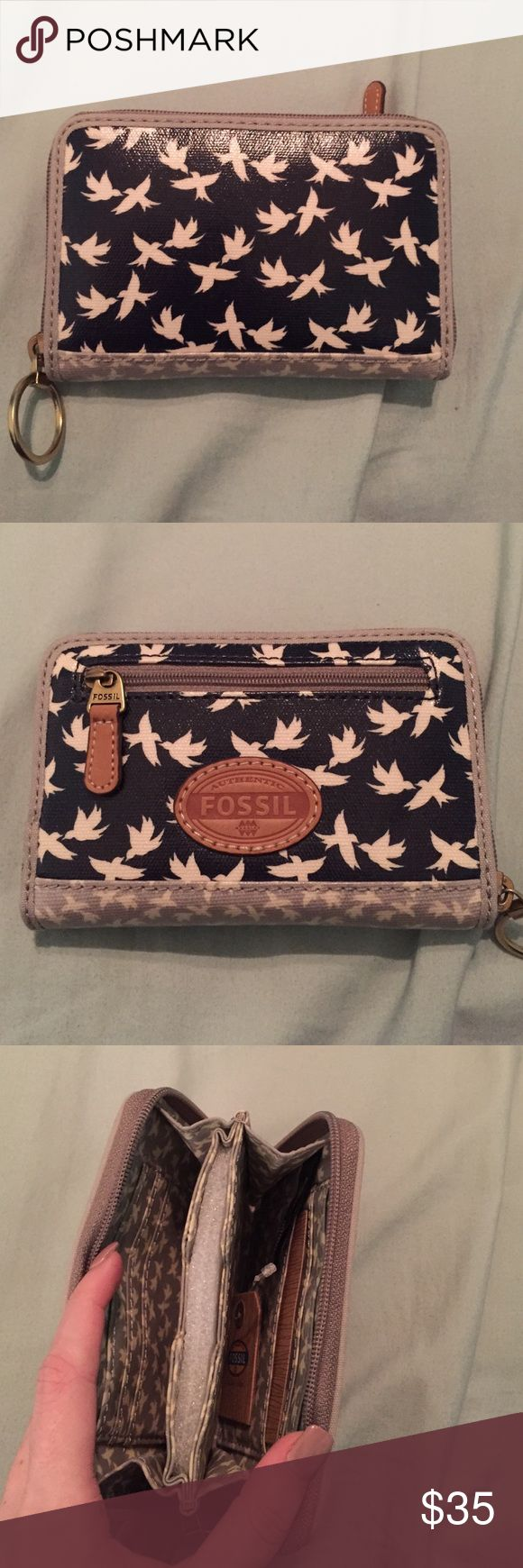 NWT Fossil Keyper Wallet NWT Fossil wallet! They don't make this collection anymore!! Super cute, never used before! No trades please Fossil Bags Wallets