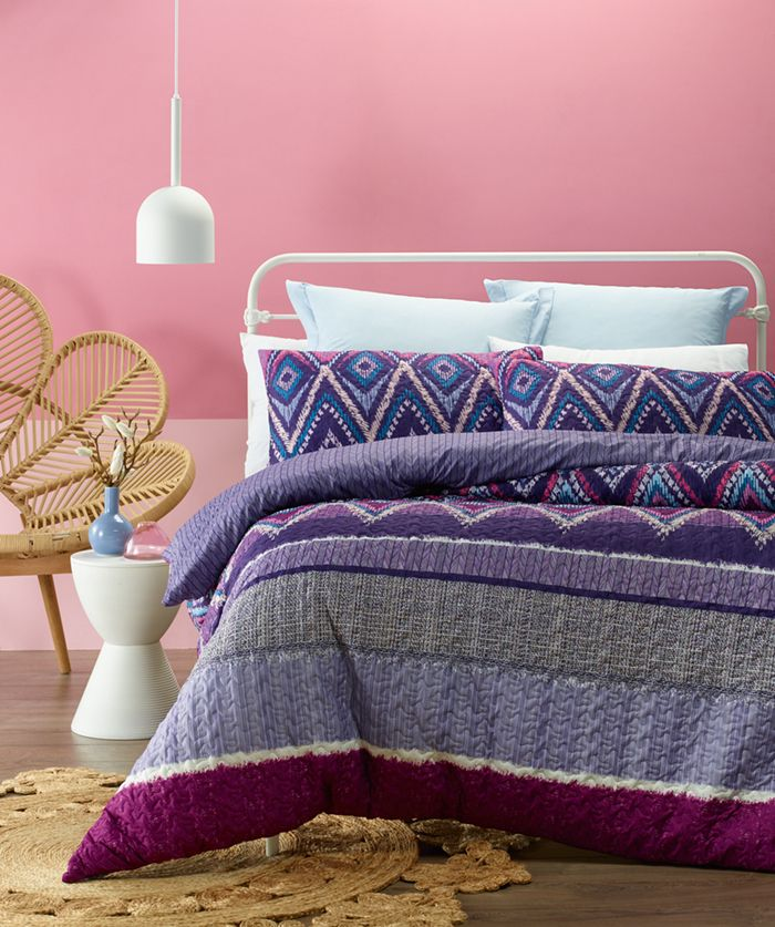 Luxurious soft touch quilted look fabric. Blend of Purple, Lilac, Mauve, Crimson, Grey and White with geometric patterns