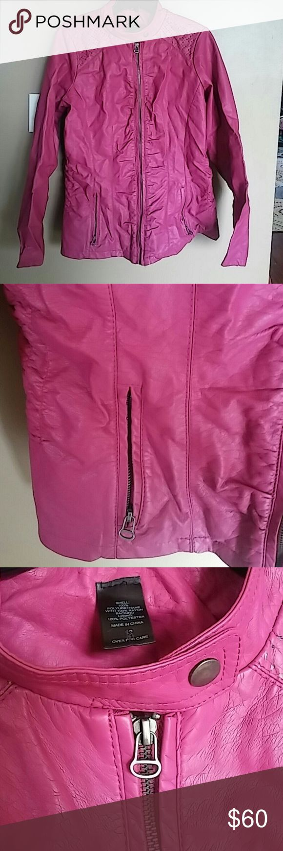 Gorgeous Plum-Pink Faux Leather Jacket This listing is for a gorgeous plum pink color faux leather jacket. The jacket is motorcycle style with a snap at the color. The front jacket has two zipper pockets. Shoulders have a lined vinted hole design. Material shell is polyurethane with 100% Rayon Backing Lining: 100% Polyester. The tag says a size 12 and the measurements are Shoulder to hem 26 in. and Armpit to Armpit 23 1/2 in.. This jacket was worn less than a handful of times by my sister…