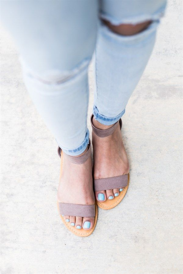 Get the look in these simple but flattering open toe, faux suede, ankle strap sandals. The simplicity of them makes them great for every outfit, but will look especially stunning in high waisted denim shorts.