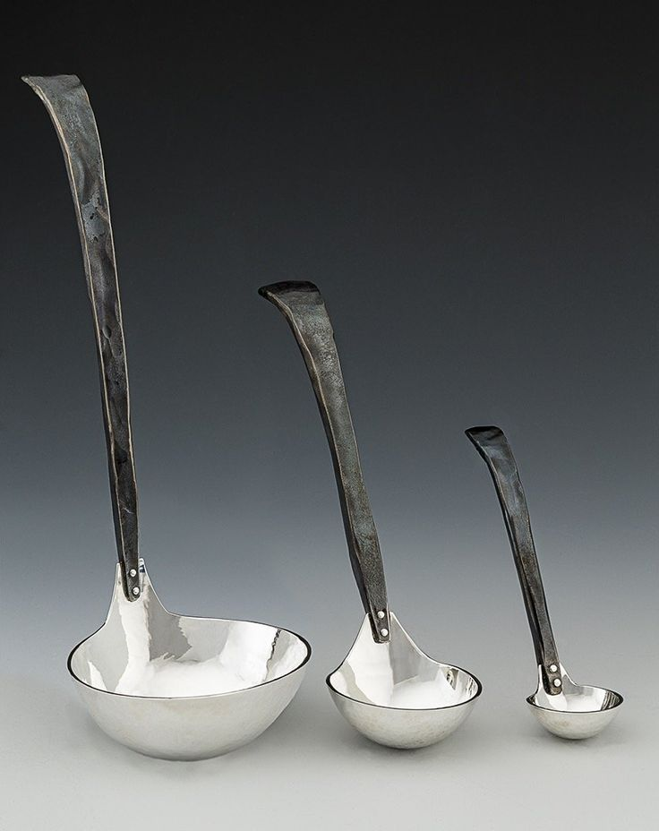Craftsman Soup Ladle by Nicole and Harry Hansen. The rustic Craftsman handle on this elegant ladle is sure to elicit comments as you serve a hearty soup on that chilly winter evening. Completely hand-forged flatware is made with 304 stainless steel handles. The color of the handles is a result of a heat patina from the forging. The artists use Argentium sterling (tarnish resistant) silver for spoons and forks. The knife blade is polished stainless. The artists recommend hand washing. If…