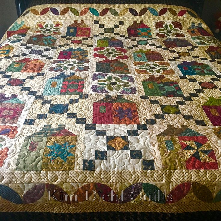 My quilting friend, Julia Wareing, shared her finished version of my Journey's End quilt with me, and it's so wonderful that I had to share. Also shared is the original design to show you just how creative and different HER quilt is. I love it when someone considers one of my designs to simply be a jumping-off point, adds their own unique touch, and creates something completely fabulous. #KimDiehlQuilts #JourneysEndBOM #CreativityHomeRun #HenryGlassFabrics