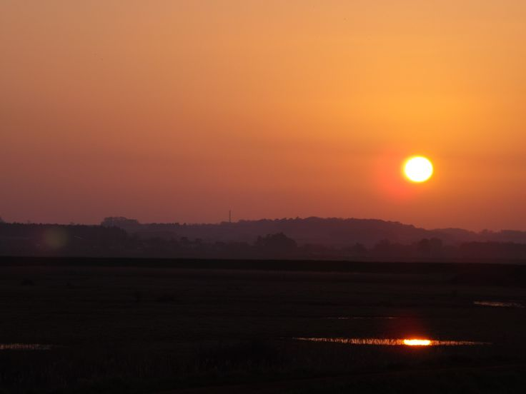 Sunset over the saltmarsh, Burnham Overy Staithe. Nelson was rumoured to have leant to sail as a young boy at the Staithe and was  born a few miles away in Burnham Thorpe.