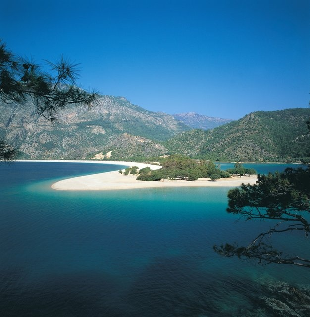 Oludeniz Blue Lagoon near ethiye,Turkey.   Who'd have thought Turkey was this magnificent?  The beauty of God's earth knows no country border...