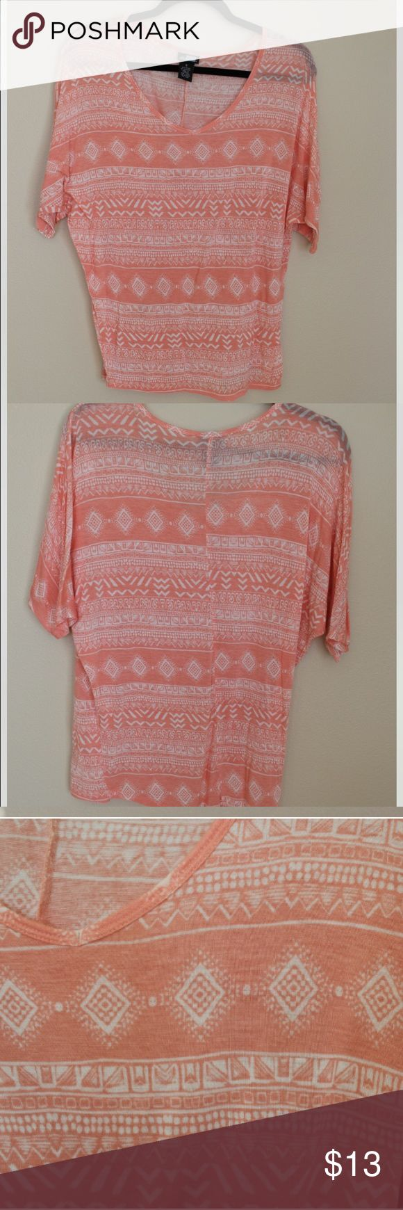 Peach & Cream Aztec Print Dolman Top. Super Soft. This slouchy dolman top is stretchy and soft. Features cream colored Aztec print on peach background. Worn a couple times. No visible signs of wear. Fits like Medium. Tops Tees - Short Sleeve
