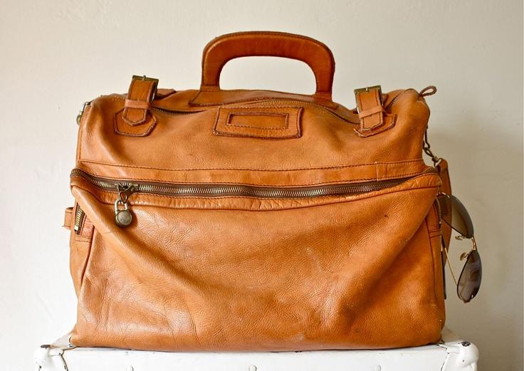 60s large leather weekender bag luggage. $165.00, via Etsy.