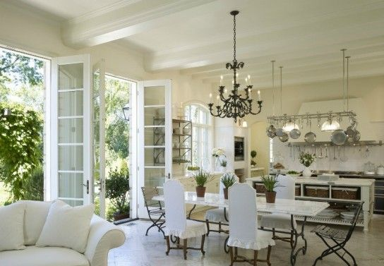 Gorgeous design for an open kitchen! Imagine that those french doors open on to a patio that goes the length of the house and falls right into a garden....