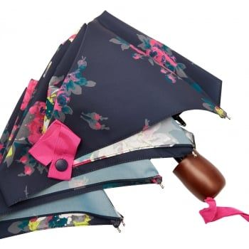 Joules ever-popular lightweight umbrellas showcase some of our most popular prints, but they're much more than just a pretty face. A smooth wooden handle is warmer on cold hands, a cover keeps it neatly in your bag when not in use and a flexible, articulated frame means when the wind blows your brolly inside out it will snap back into shape easily, without fear of breaking.  http://www.marshallshoes.co.uk/accessories-c46/joules-french-navy-floral-brolly-umbrella-p4139