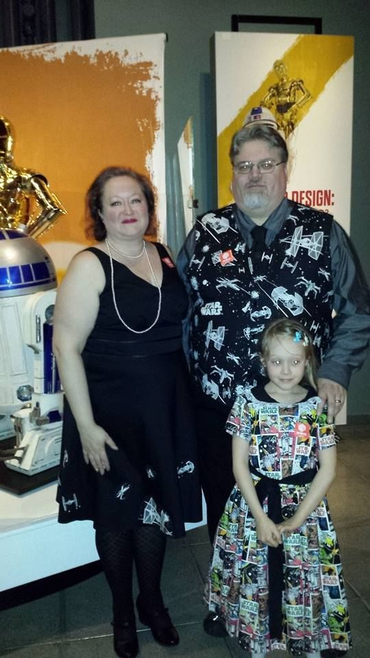 Star Wars Gala @ EMP Appliqued store bought dress for mom using cut outs of the ships of the same material as dad's custom vest.  Daughter is made from a vintage pattern.