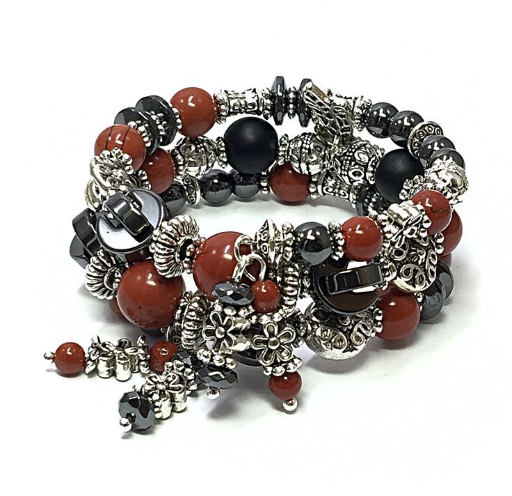 This alluring dragonfly bracelet captures the essence and hues of a red and black dragonfly. The silver-tone beads represent the water where the dragonfly larva lives when it is hatched. Dragonflies are considered good luck, so why not where one on your wrist. Most of the coloring of a dragonfly is usually on its 'tail' and wings. The red jasper beads and black onyx beads represent the black and red dragonfly species.