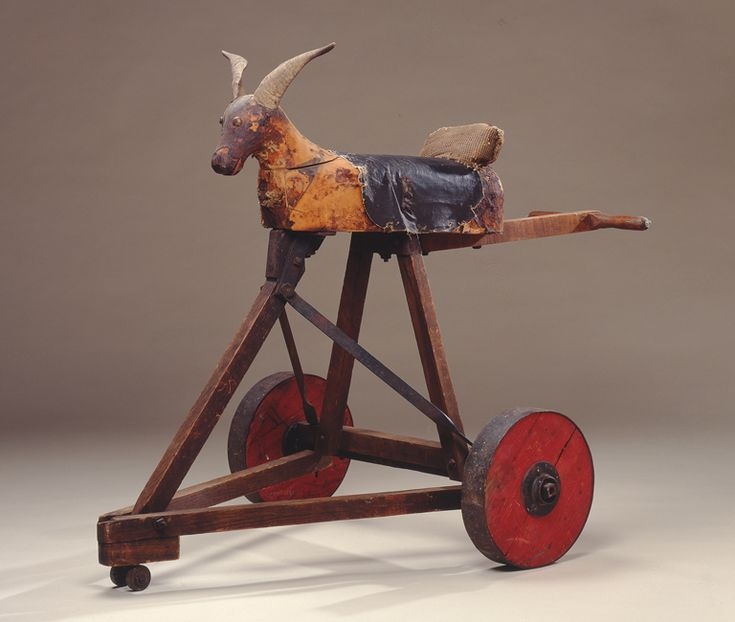 Riding Goat on Wheels, ca. 1923 Carved and assembled wood, steel, goat horns, fabric, leather, carpet, tacks, and newspaper