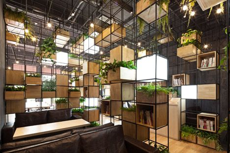 "Penda_Home Cafe // Based on the idea of creating ""spaces to breathe in heavily polluted areas of China"", the designers incorporated air-purifying plants and herbs that create fragrances to complement the smell of brewing coffee. ""The structural grid offers a space, where various cubic elements can be implemented,"" said the architects. ""By organising the cubes, the modular system allows a flexible assembly for different occasions."""