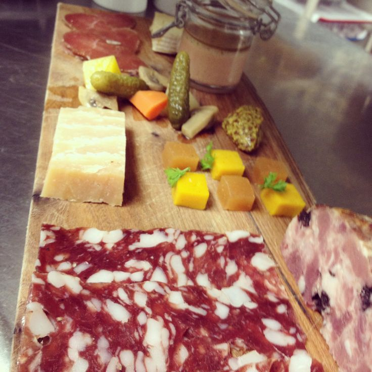 Duo of cheeses and house made charcuterie